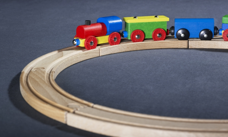 2226560-colorful-wooden-toy-train-on-tracks
