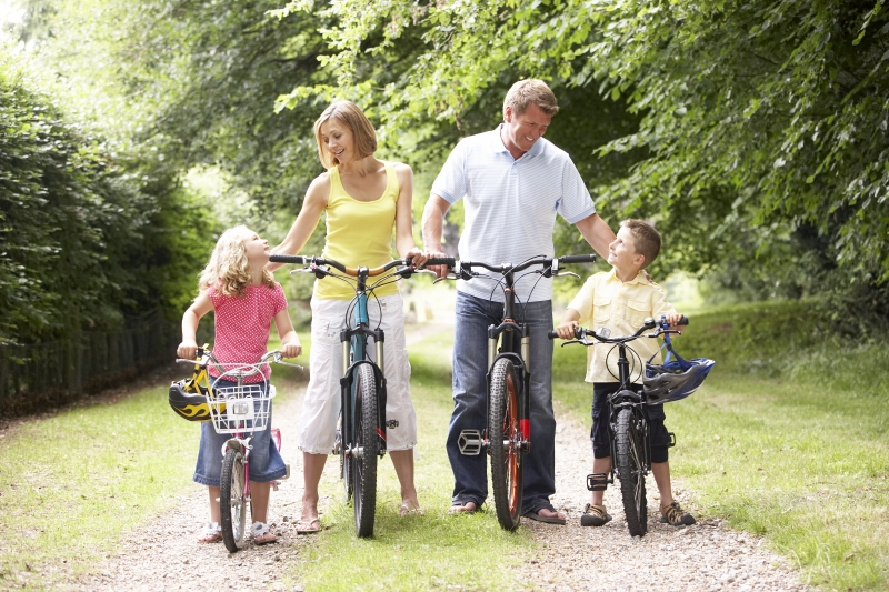 2176101-family-riding-bikes-in-countryside